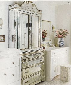 Mirrored armoire in glam bathroom