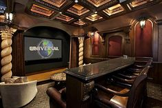 Tuscan style theater with coffered ceiling