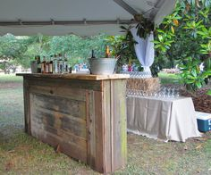 An outdoor bar is a great idea for a marquee wedding