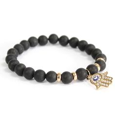Black Agate and Gold Hamsa Bracelet. The Hand of Hamsa is a popular good luck symbol, said to protect and bring happiness to the owner. Price is per bracelet. Agate Gemstone, Gemstone Jewelry, Stretch Bracelets, Beaded Bracelets, Swarovski, Black Agate, Boho Jewelry, Jewellery, Bracelets