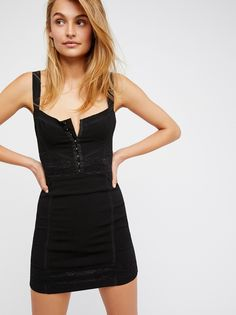 Lace Me Up Bodycon   Bodycon mini dress featuring a slim, next-to-skin fit with lacey details and corset-style hook-and-eye closures along the front.    * Stretchy fabrication