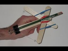 How to make a Popsicle Stick Crossbow  (Watch Video)  With the popularity of my original popsicle stick crossbow, I decided to look back on that project and see how I could improve upon it. This is the design that was developed.   ORIGINAL Popsicle Stick Crossbow:  How to make a Mini Crossbow https://www.youtube.com/watch?v=mekzwUMdWtg  www.specificlove.com