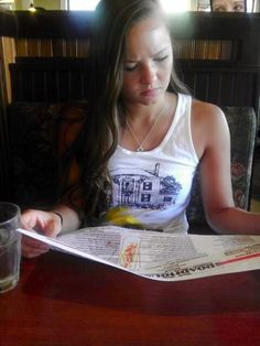 This girl get this photo taked in a restaurant. When she and her friend notice the woman in the back they return to the restaurant asking if they know about any paranormal activity in the place and they say that there is a ghost of a short woman in the restaurant.
