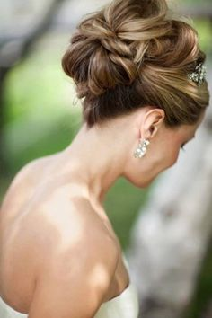 love this dramatic bridal updo ~  we ❤ this! moncheribridals.com