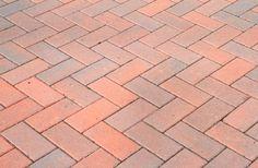 Classic herringbone brick patio pattern