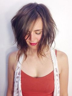 messy bob hairstyle with bangs for shoulder length hair