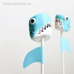 Shark marshmallow pops are a fun food idea for Shark Week, and a great summer party food idea. Marshmallows, candy melts, and food coloring pens.