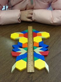 Teaching Tales Along the Yellow Brick Road: Geometry Unit and Symmetry Activity