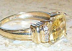$99 Size: 7  Color: golden citrine  Type: 10k gold  Country of Origin: United States  Manufacturer: Artisan Handcrafted    Dainty elegant ring has FOUR SMALL DIAMONDS ON EACH SIDE OF CITRINE. SIZE 7.25