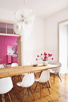 Simple dining room with white Eames dining chairs.