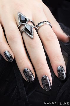 This silver and black cobweb mani is just the right mix of spooky and glam for Halloween! All you need is some saran wrap and Color Show in 'Onyx Rush' and 'Petal to the Metal'.