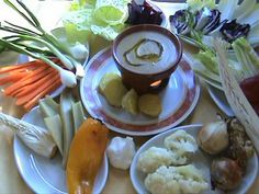 """""""Bagna cauda"""" is a typical gastronomic specialties of the Piedmontese cuisine, is a preparation made with garlic, olive oil and anchovies, all reduced to a sauce by cooking, is brought to the table in its baking pan and kept at the right temperature. It consumes dipping various kinds of seasonal vegetables usually divided between raw and cooked"""