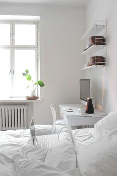 Best All White Room Ideas White Clean Bedroom Shelves Bedding 35 all-white room ideas. Discover photos of living rooms, bedrooms, kitchens, and bathrooms decorated in all white decor. Find monochrome white rooms that will inspire your own decor. Bedroom Workspace, Clean Bedroom, Shelves In Bedroom, Home Bedroom, Bedroom Decor, White Desk Bedroom, Master Bedroom, Bedroom Cupboards, Desk In Small Bedroom