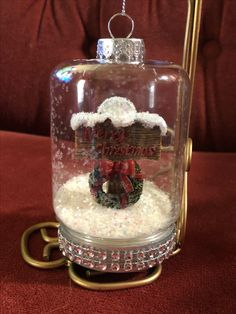 Snow globe style ornament. Miniature sign inside with fake snow and crystals around the base. Completed 11/10/17.