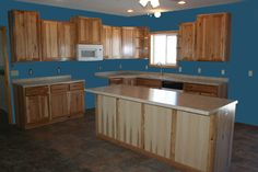 Hickory cabinets with DARK floor and LIGHT colored counter tops
