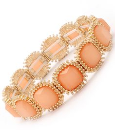 This stretch bracelet is Formica construction with colored crystals faceted. The bracelet is metal casting and available in five (5) color variations. Size: 15mm Width - Color: Peach $27.99