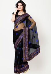 Add a touch of glamour to your persona by wearing this black coloured saree from Adaa. Designed to impress, this saree features an eye-catching thread and zari work. Black in colour, it is a must-have for a diva like look. The net fabric further adds to its demand, as it is light and comfortable to wear.