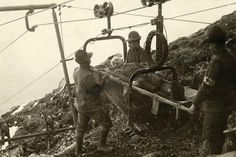MAR 15, 1916 - Fifth Battle of the Isonzo.  Pictured - A wounded Italian soldier is attached to a cable car to be brought down to the rear.