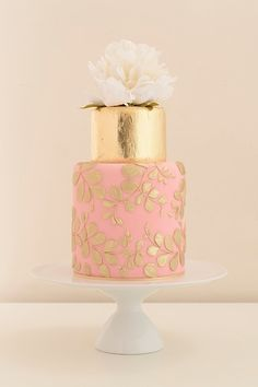 Frances Confident and sophisticated, with gold leaf and blush pink with golden piped details.