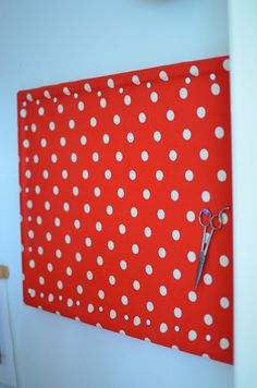 Easy fabric covered bulletin board...a remnant from Walmart, staplegun, push pins and DONE!