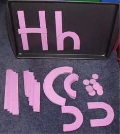 Use straight or curved cut up paper to create capital and lower case letters.