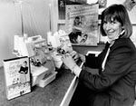 Suzie Coleman demonstrates how to use the Bernette Fun Lock sewing machine in the Bernina store in Kingston. This photograph was published on p.13 of The Canberra Chronicle on 17/​10/​1989.