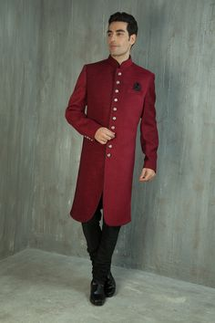Red jute nawabi sherwani highlighted with silver buttons. Item number M15-29