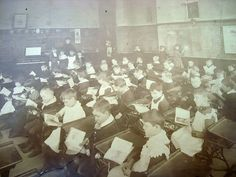 Titusville,Pa. School in the height more or less of the oil boom. There is a portrait of President James Garfield above the chalk boards which indicates the year 1880-81. Notice a good number of the boys wearing dresses and laced collars.