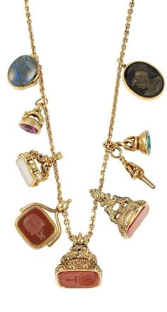 Gold Chain Necklace with Antique Gold and Hardstone Fobs and Gold Chains, seven seals, one foiled-back amethyst, rhodonite & lapis pendant with French assay mark.