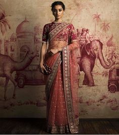 Maroon net Saree with heavy Emboridery blouse piece To purchase this product mail us at houseof2@live.com or whatsapp us on +919833411702 for further detail --- I also love the print on the wall.