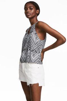 Mouwloze top - Zwart/dessin - DAMES   H&M NL 1