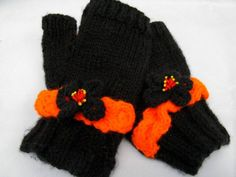 On a knitting binge right now.  Don't know why but here's my latest creation.  Black and Orange fingerless gloves with hugs and kisses cable and knitted flower accents