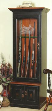 Gun cabinet very nice looking with two wood tones and lights