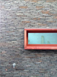 verbouwing woning te Kruibeke ontwerp Isabelle Van Lierop (Ring Partners Architecten) iov a1 architecten  baksteen - hout (padoek)