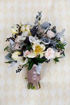 Bouquet. Love the powdery blue with hints of yellow and blush pink