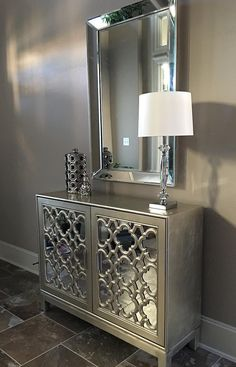 Mirror, Mirror...just one gorgeous wall mirror can enhance and add depth to even the smallest of spaces, but layering in even more mirrored elements (like our Anderson Cabinet) takes luxe to the next level. Photo submitted by @iheartcouponin.