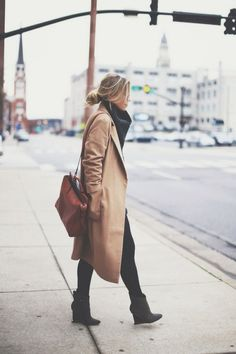 a trench coat works well with all black in fall and on milder winter days