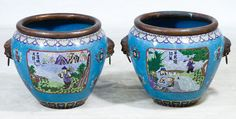 Lot 560: Asian Cloisonne Planters; Pair of contemporary planters having outdoor scenic panels and dogs handles