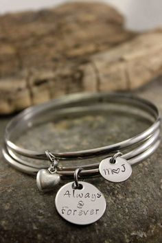 Hand Stamped Stainless Steel Bangle by StampedFrosting on Etsy, $20.00