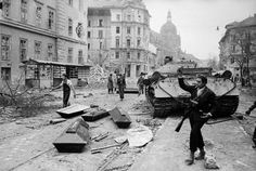 A disabled tank near coffins being used for the bodies of Russian soldiers killed during the popular uprising against the Communist-backed Hungarian government, Budapest, By Michael Rougier. Life Pictures, Old Pictures, Old Photos, Soviet Army, Soviet Union, Central Europe, Budapest Hungary, Historical Pictures, Life Magazine