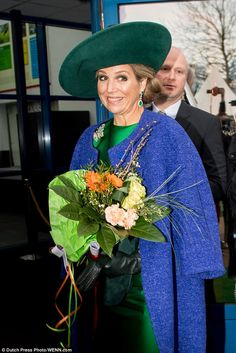 Maxima wore a brilliant satin frock, which she accessorised with a glittering butterfly broach