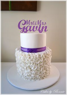 Ruffle cake with a touch of purple , wedding cake..**Cakes by Bonnie**