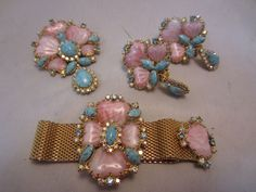 "3 PIECES INCLUDING "" FOLD OVER "" BRACELET, BROOCH AND EARRINGS. POURED PINK GLASS HEARTS. ALL STONES INTACT AND BRILLIANT. GOLD FINISH NEAR MINT CONDITION. ONLY EARRINGS ARE SIGNED "" HOBE "". NATIONAL RATES ARE FOR THE CONTIGUOUS UNITED STATES. 