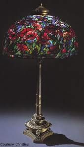 Tiffany poppy floor lamp, circa Another example showing off flowery designs and patterns. A lovely piece overall and superbly crafted. Tiffany Stained Glass, Stained Glass Lamps, Tiffany Glass, Leaded Glass, Mosaic Glass, Louis Comfort Tiffany, Victorian Lamps, Antique Lamps, Vintage Lamps