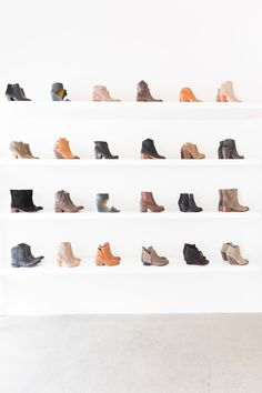we have died and gone to bootie heaven with this wall of goodies from The Perfect Pair in Nashville Photography: Alyssa Rosenheck Photography - alyssarosenheck.com  Read More: http://www.stylemepretty.com/living/2014/11/13/fashion-essentials-with-the-perfect-pair-nashville/
