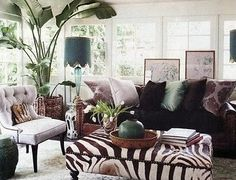 Pizzazz Home Decor Blog — Urban Safari...It's a Jungle in Here! (LOVE all the windows/French doors [?]; zebra-print oversized ottoman is nice, too)