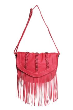 This is another amazing crossbody bag! The tassels make this bag boho chic, and the color really makes it pop! If you don't know the meaning of 'bringing the essentials', then you'll probably want a bigger bag.