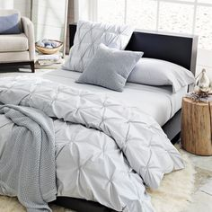 Great tutorial on how to make a pin tucked duvet cover!