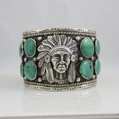 Navajo Sterling and Turquoise Chiefs Head Bracelet - $1,800.00.  From Sterling925.net.