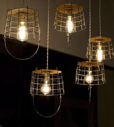 RECLAIMED STEEL BASKET LIGHTING PENDANT Made from repurposed golf ball baskets  $ 198